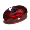 Cut ruby gemstone with inclusions