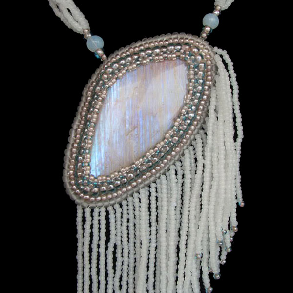 Belomorite cabochon in a piece of beaded jewelry
