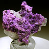 Sugilite on a matrix of barite crystals